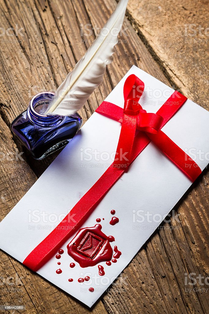 Elegant letter with red sealant and blue ink stock photo
