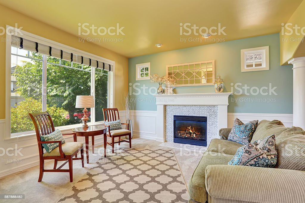 Elegant living room interior with yellow ceiling stock photo