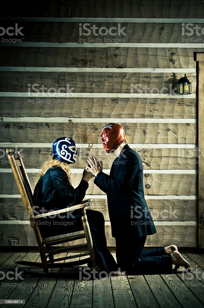 elegant lucha libre wrestler proposing matrimony royalty-free stock photo