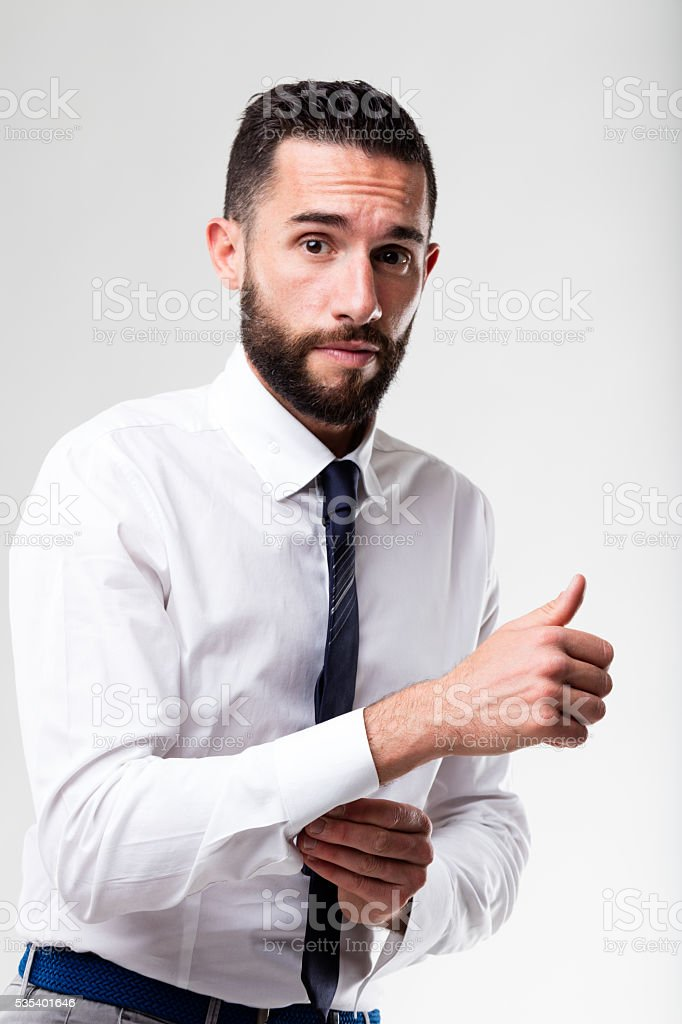 elegant man hesitant while dressing up stock photo