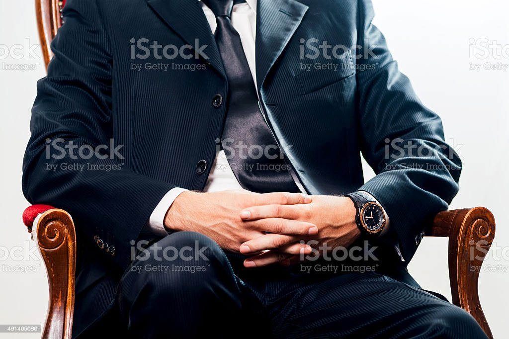 Elegant man in a suit hands crossed royalty-free stock photo