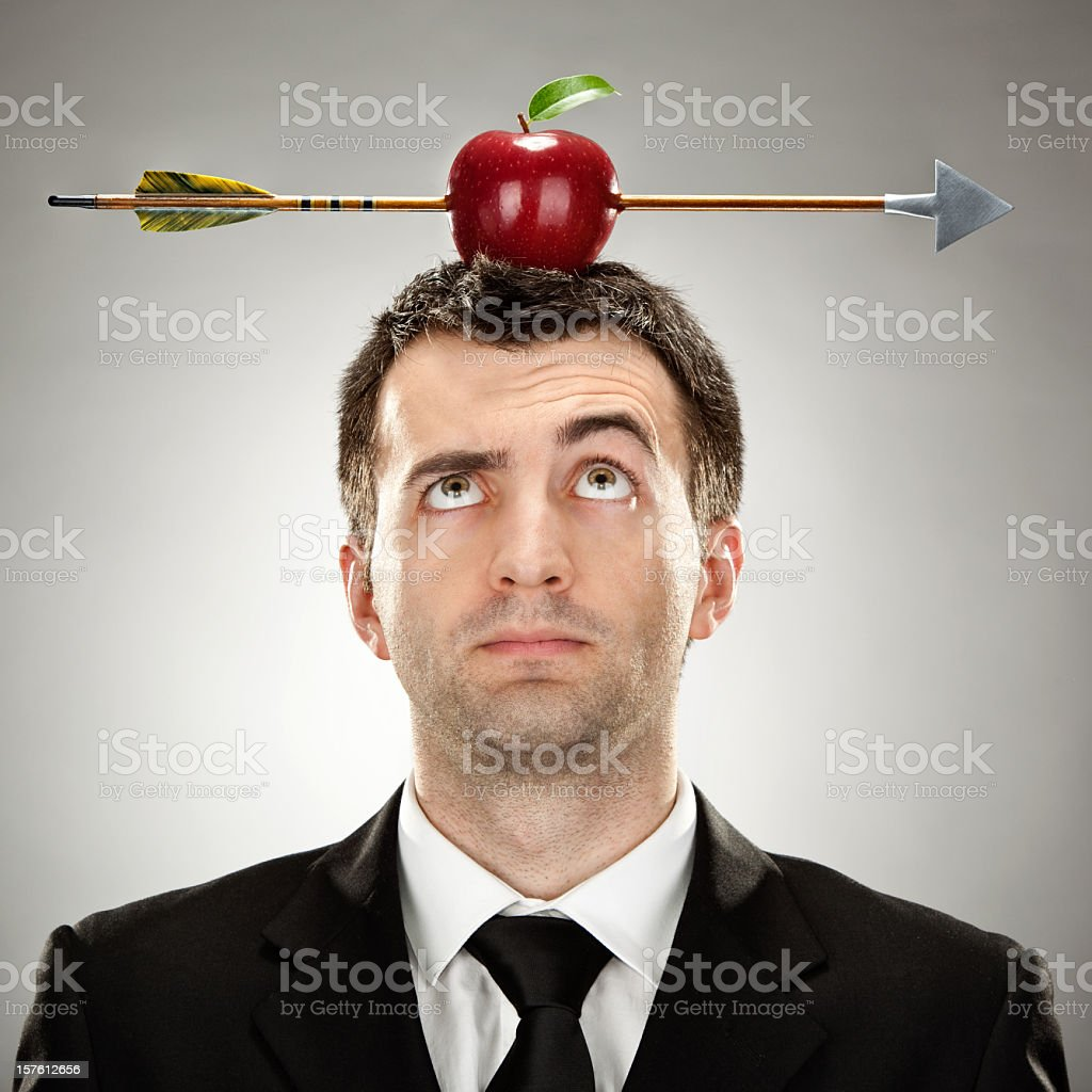 Elegant man with an apple on his head hit by an arrow royalty-free stock photo