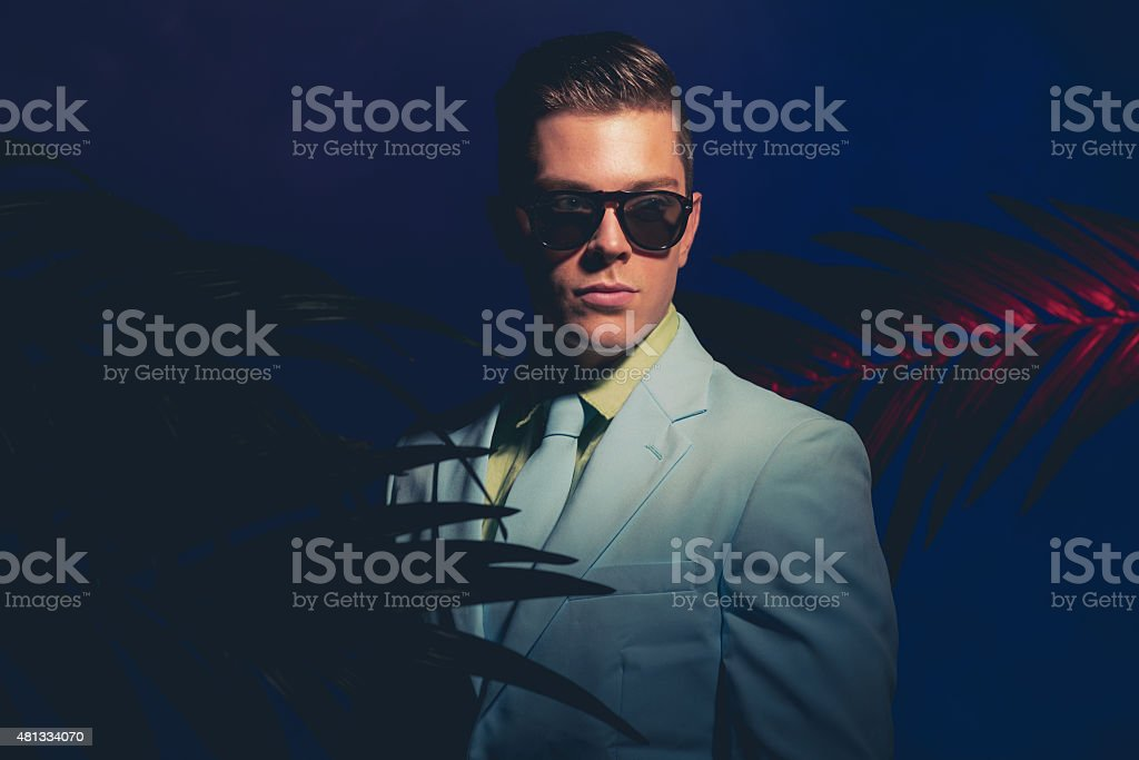 Elegant Man with Shades Standing Like Mannequin stock photo