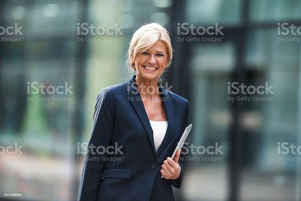 Elegant mature businesswoman stock photo