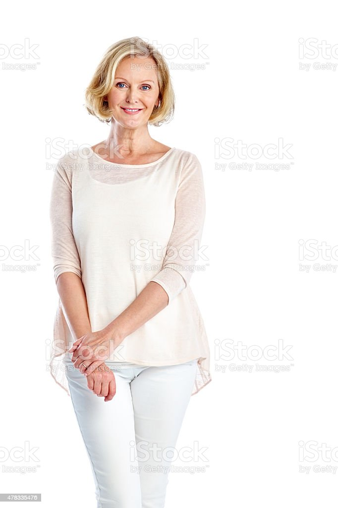 Elegant mature woman standing on white stock photo