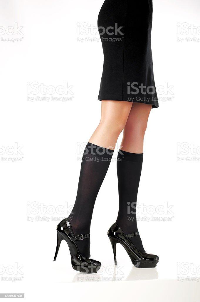 elegant model legs with  black skirt, fashion shoes and half-hose stock photo
