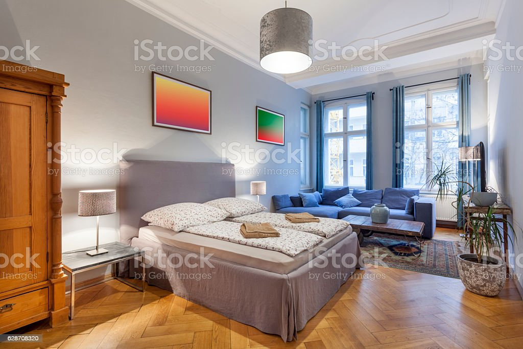 Elegant Modern Bedroom With Couch stock photo