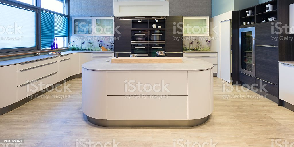 elegant modern kitchen with varnished and rounded front elements stock photo