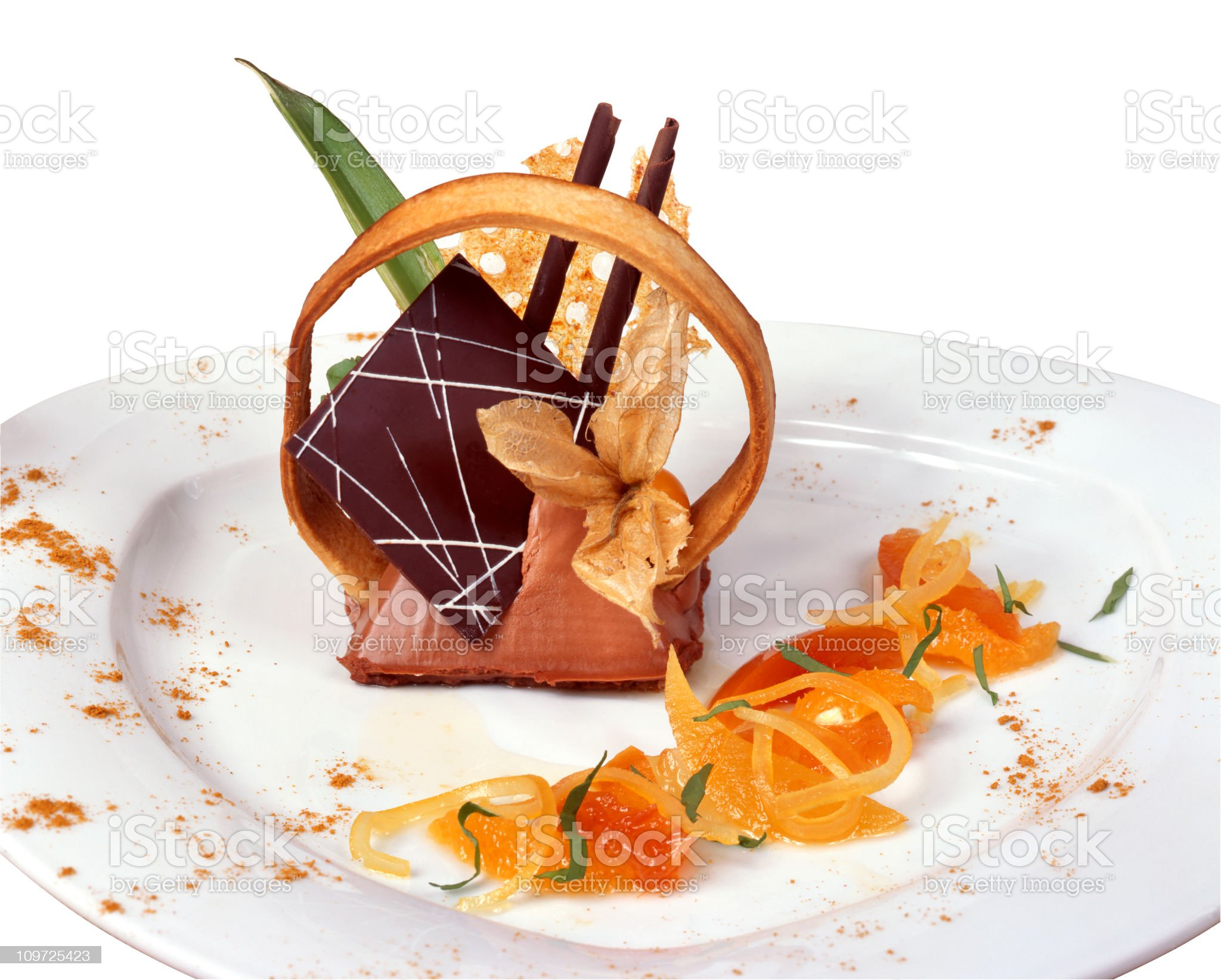Elegant mousse with many garnishes on a white plate royalty-free stock photo