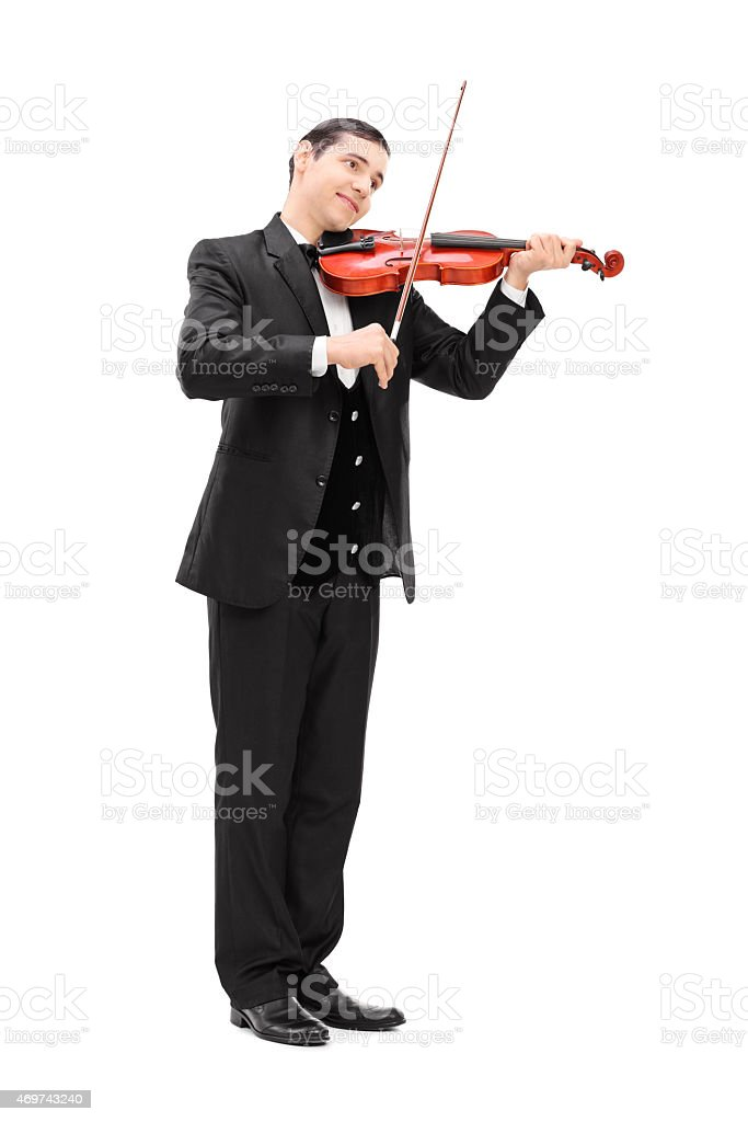 Elegant musician playing an acoustic violin stock photo