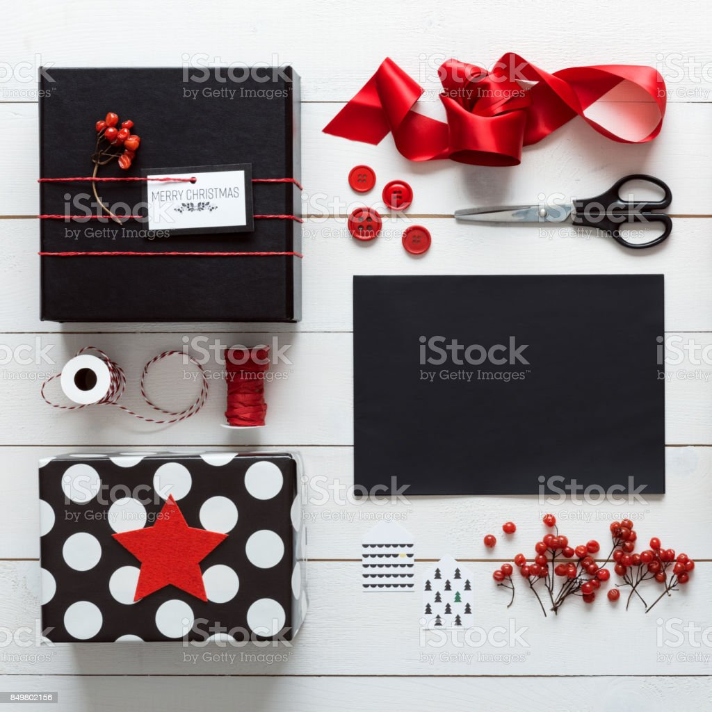 Elegant nordic retro christmas, wrapping station, desk view from above stock photo