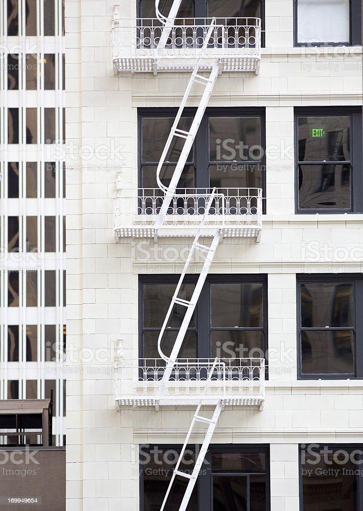 Elegant old fire escape ladders stock photo