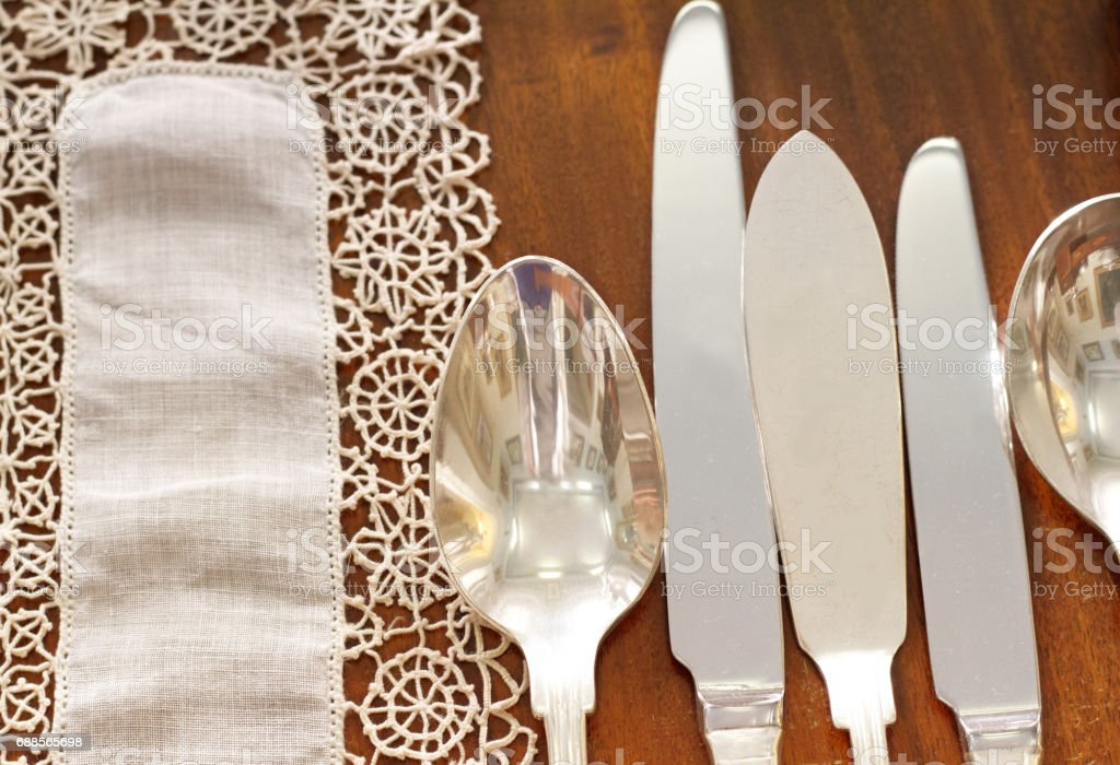 Elegant Old-Fashioned Table Setting with Knives and Spoons (Close-Up) stock photo