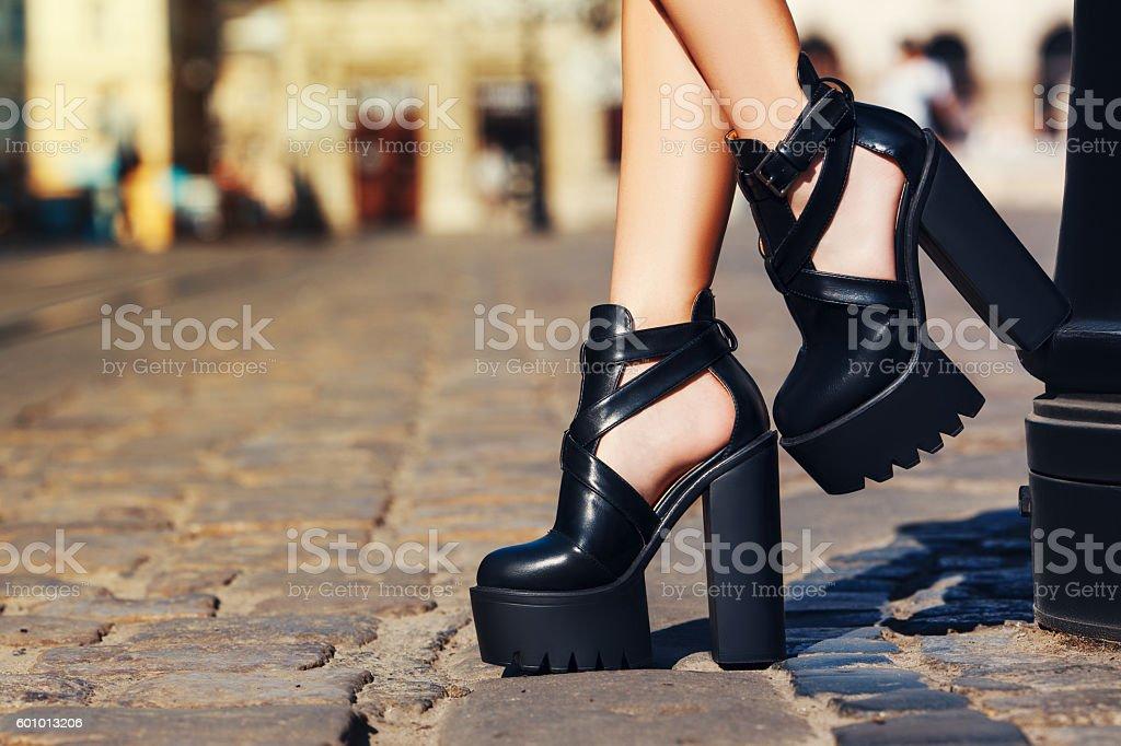 Elegant outfit. Closeup. Stylish black leather summer shoes. Fashionable girl stock photo