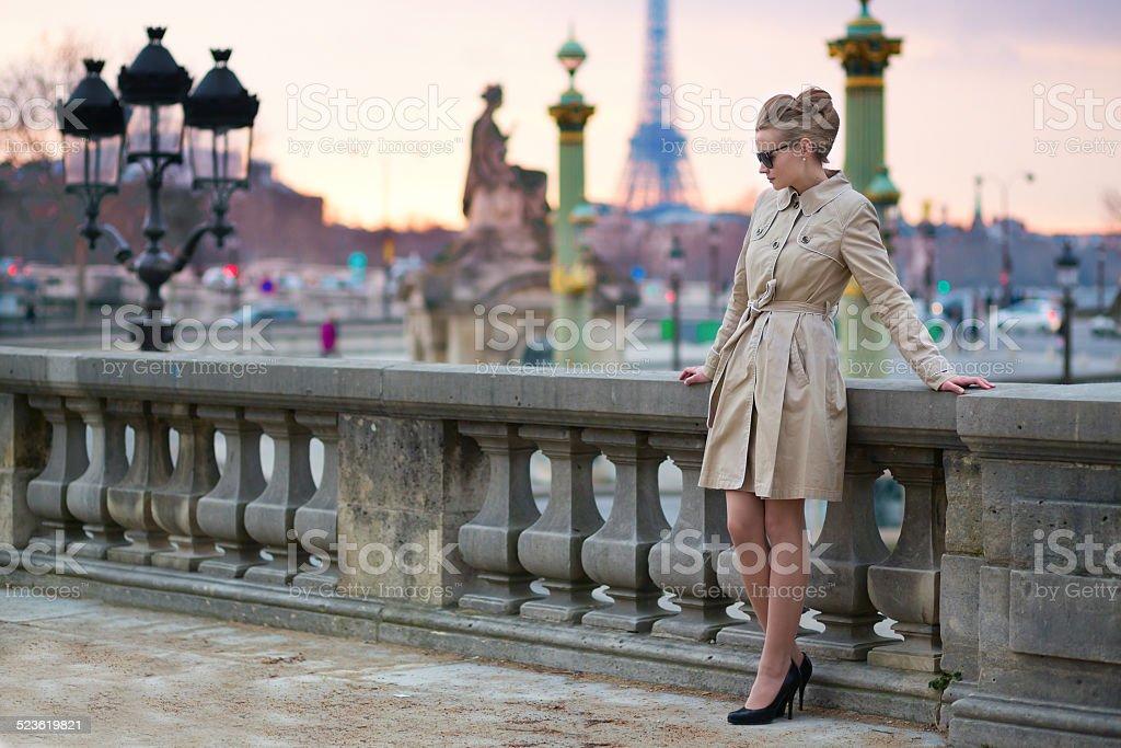 Elegant Parisian woman in the Tuileries garden stock photo