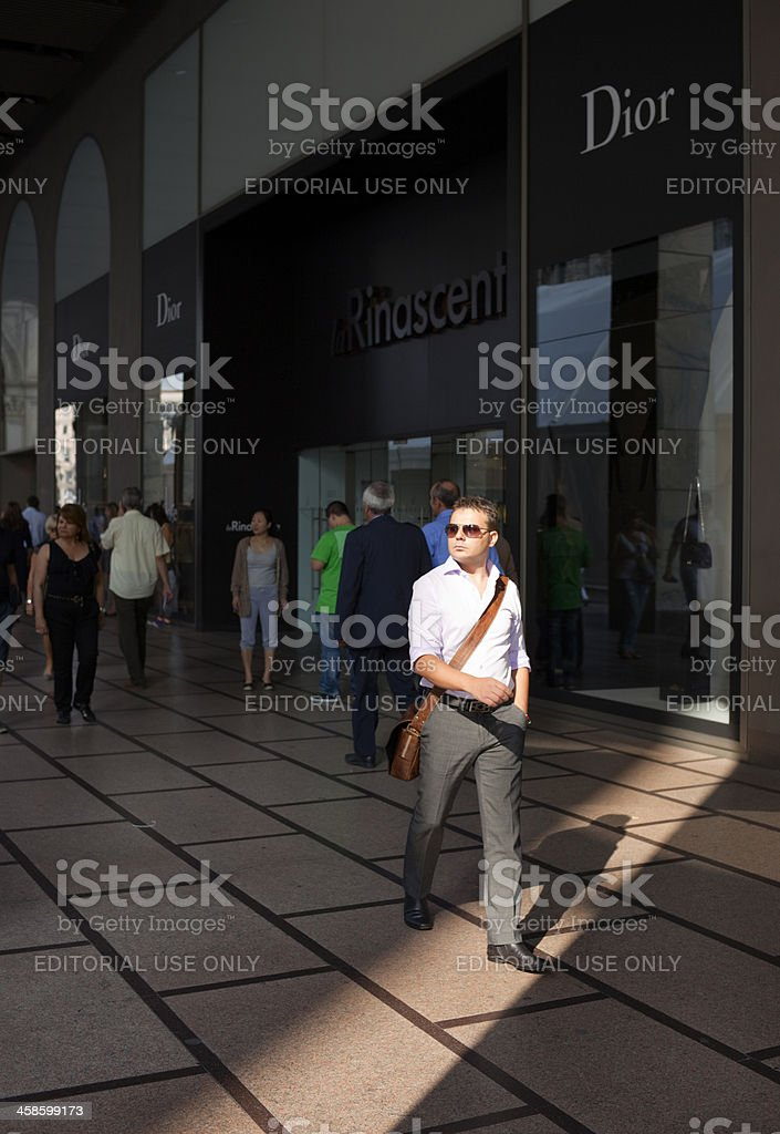 Elegant passer-by stock photo