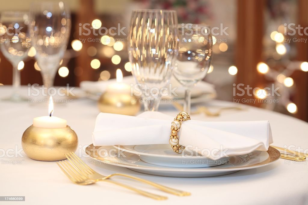 Elegant Place Setting with gold, white and crystal stock photo