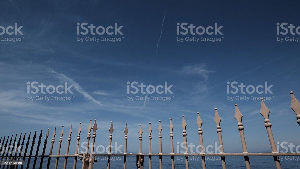 Elegant railing against blue sky - Copyspace stock photo