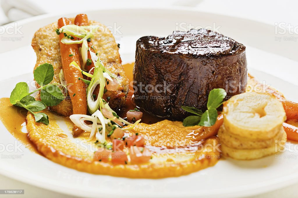 Elegant restaurant serving of fillet steak with glazed vegetables stock photo