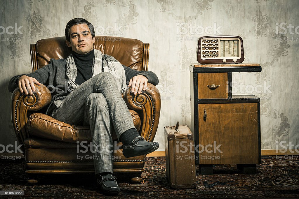 Elegant Retro Man Sitting in Vintage Room stock photo