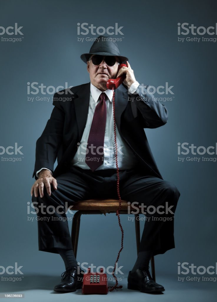 elegant senior man speaking on a vintage phone royalty-free stock photo