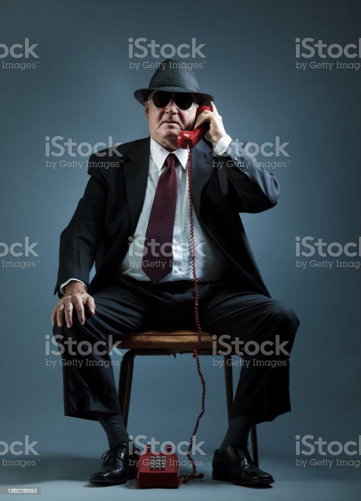 elegant senior man speaking on a vintage phone stock photo