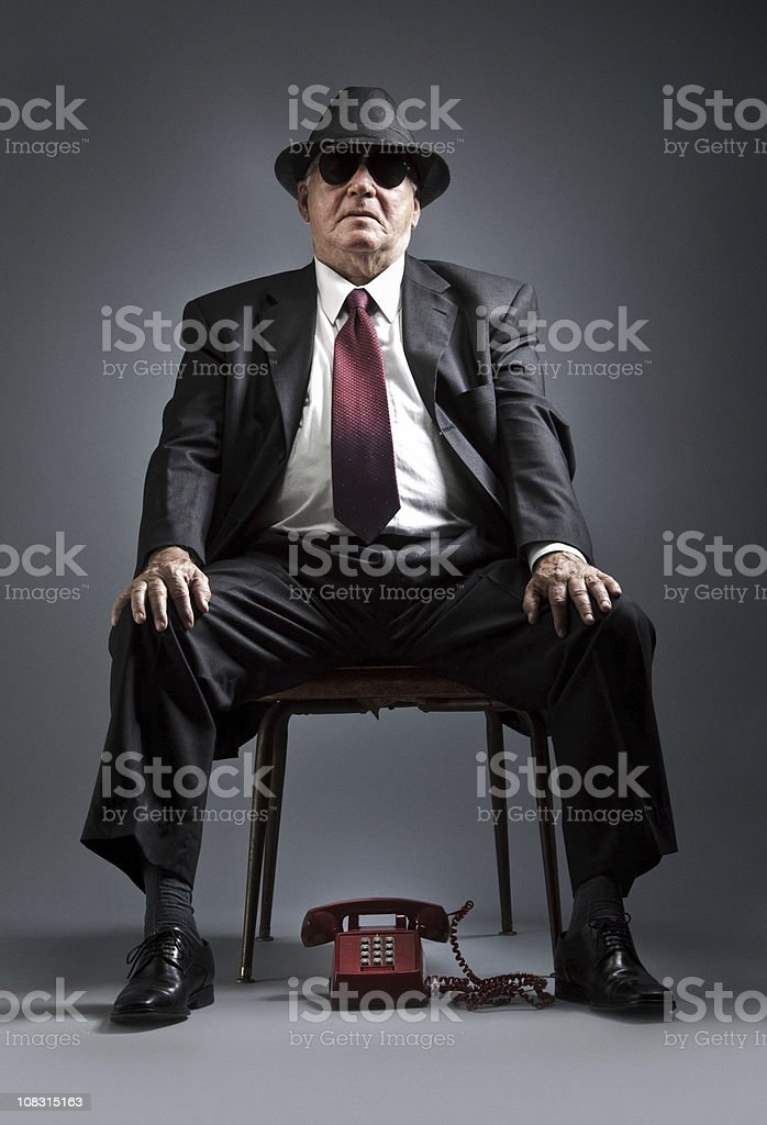 elegant senior man waiting for a phone call stock photo