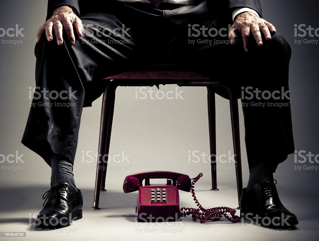 elegant senior man waiting for a phone call royalty-free stock photo