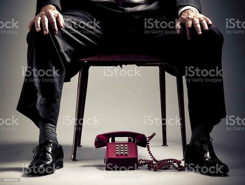 elegant senior man waiting for a phone call stock photo