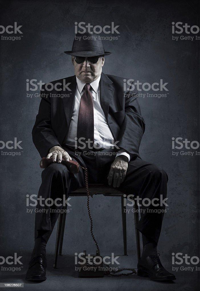 elegant senior man with vintage phone stock photo