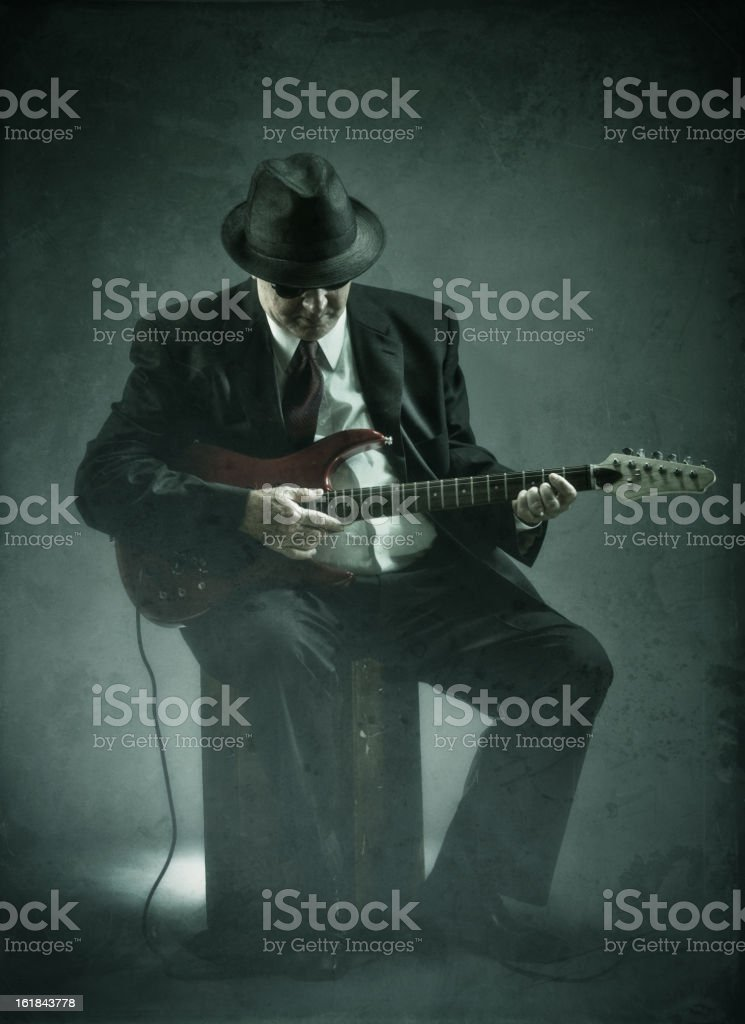 elegant senior playing an electric guitar stock photo