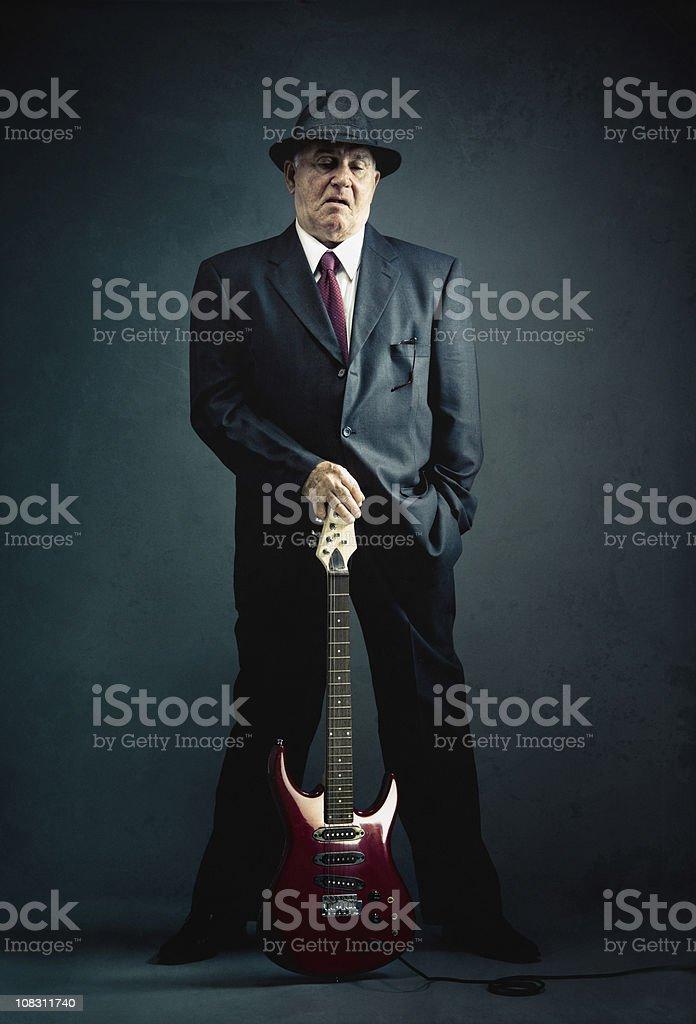 elegant senior with an electric guitar royalty-free stock photo