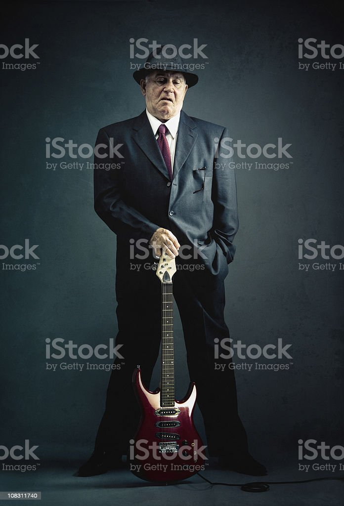 elegant senior with an electric guitar stock photo