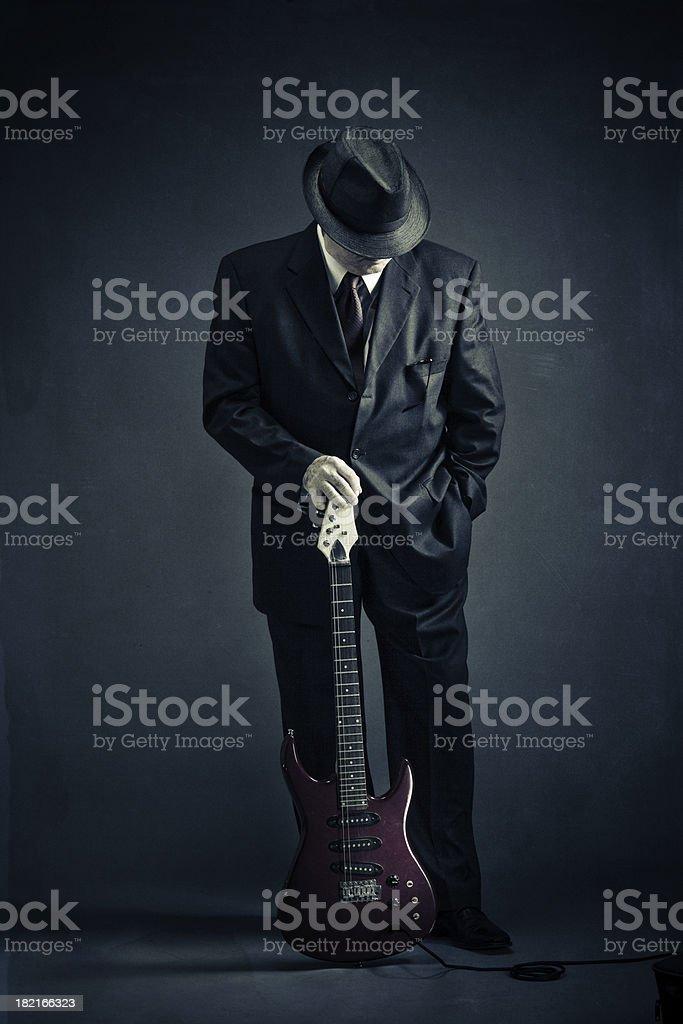 elegant senior with an electric guitar stock photo