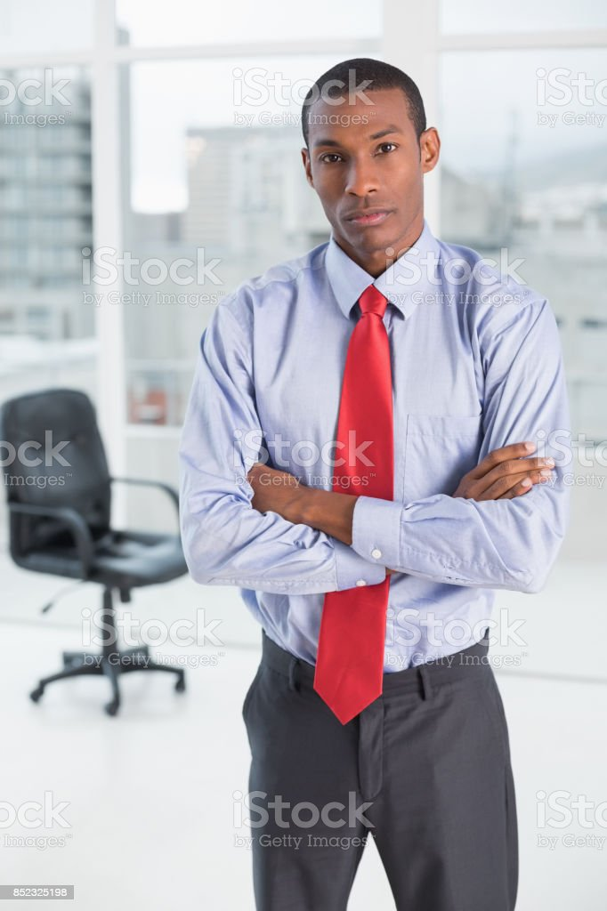 Elegant serious Afro businessman in office stock photo