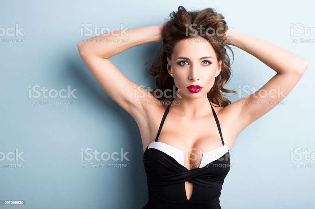 Elegant sexy woman in a bathing suit shapely body. stock photo