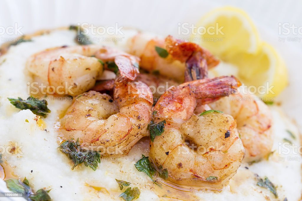 Elegant shrimp and grits served on white plate  stock photo