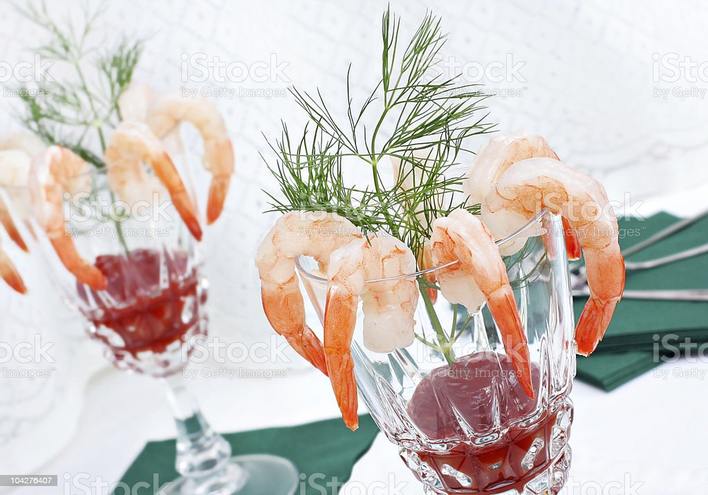 Elegant shrimp cocktail in crystal glasses with dill garnish. royalty-free stock photo