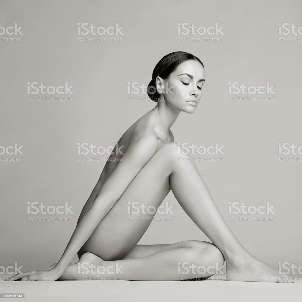 Elegant sitting lady stock photo