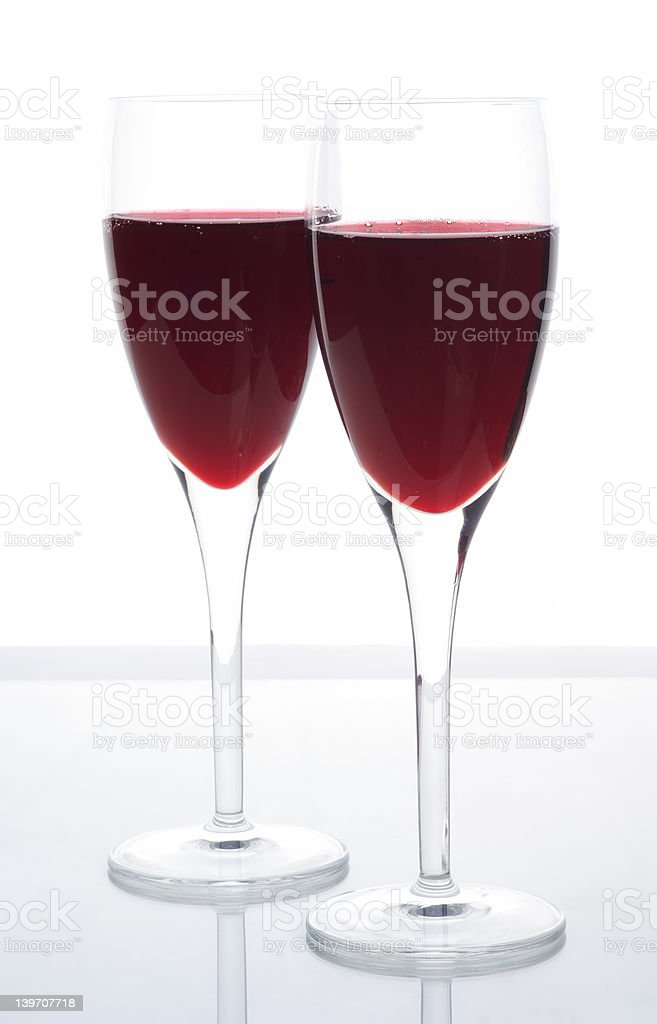Elegant sparkling red wine served in Champagne flutes royalty-free stock photo