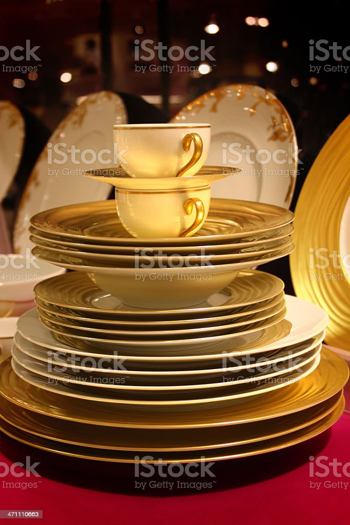 Elegant stack of dishes and cups royalty-free stock photo