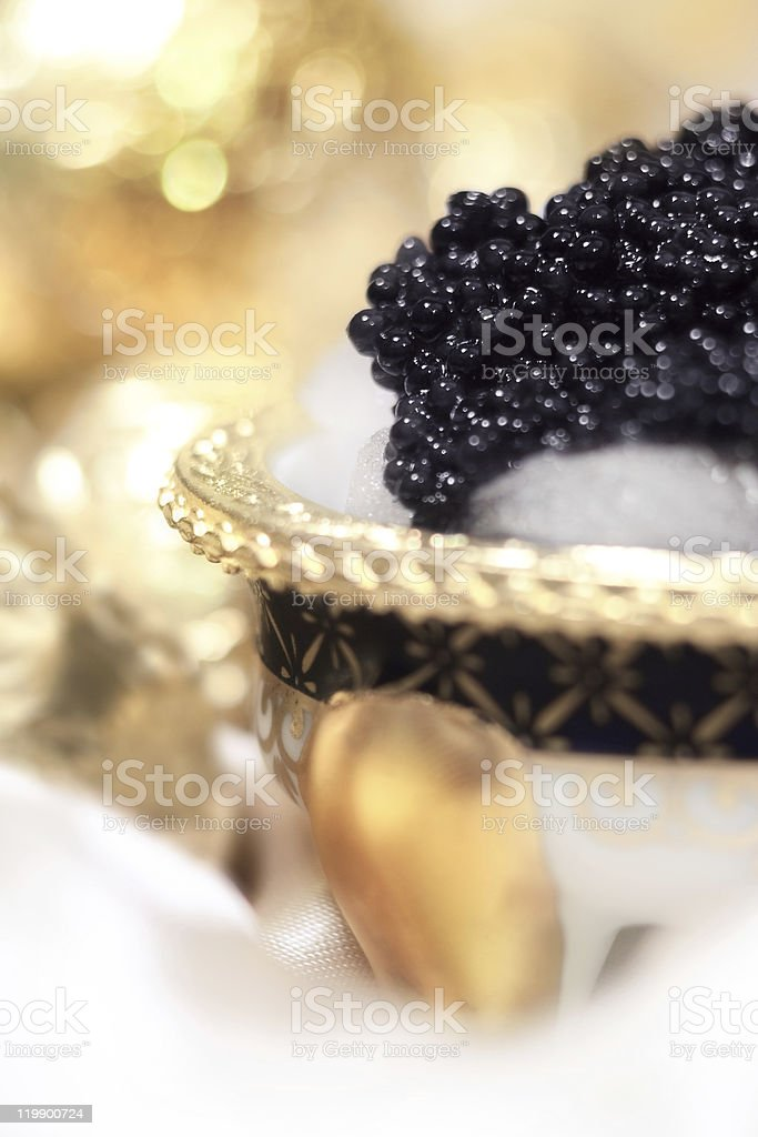 Elegant styling black caviar on ice. stock photo