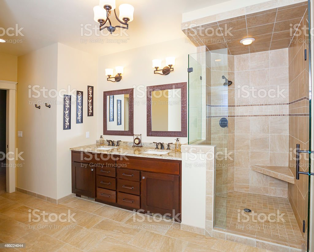 Elegant Stylish Bathroom With Glass and Tile Shower, Marble Counters stock photo
