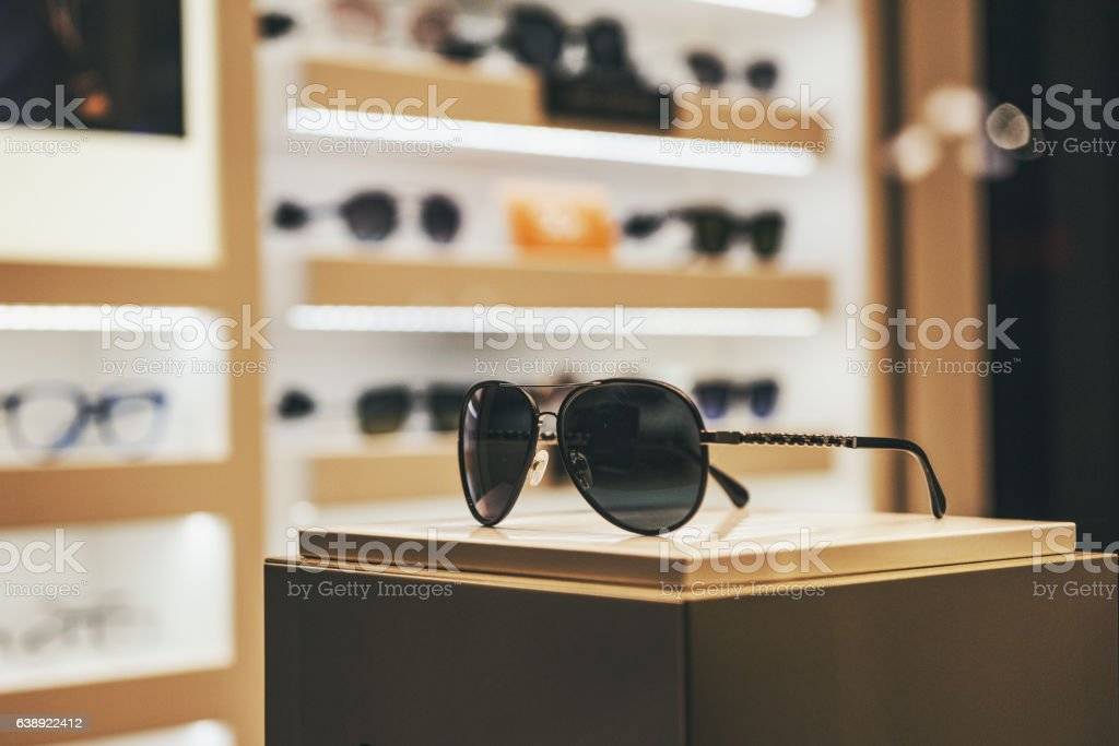 Elegant sunglasses in a fashion store showcase stock photo