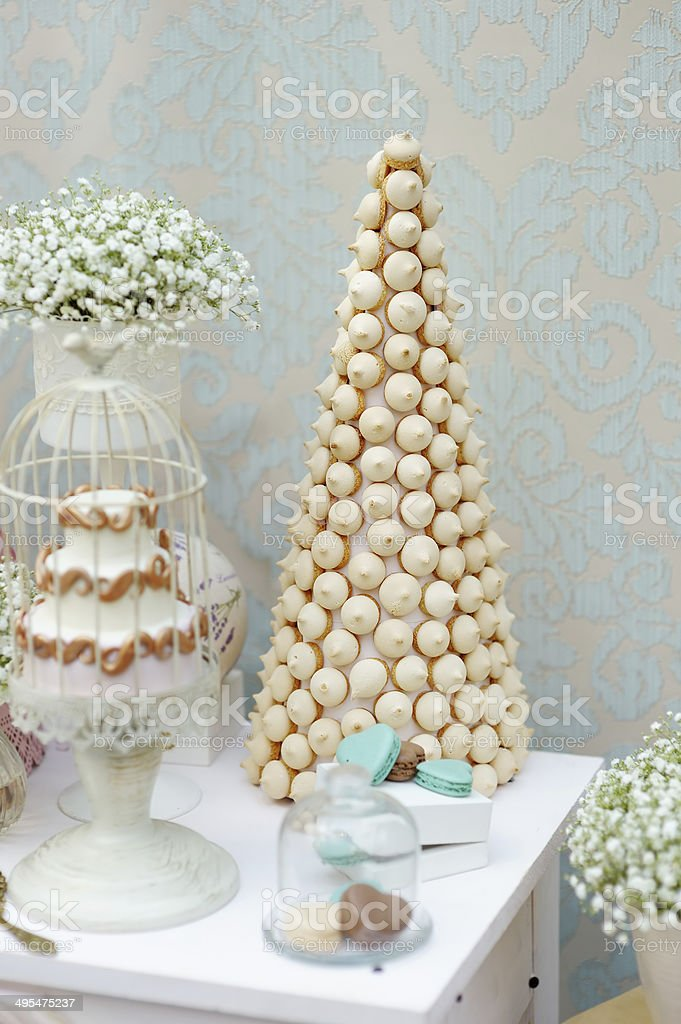 Elegant sweet table with cake and macaroon royalty-free stock photo