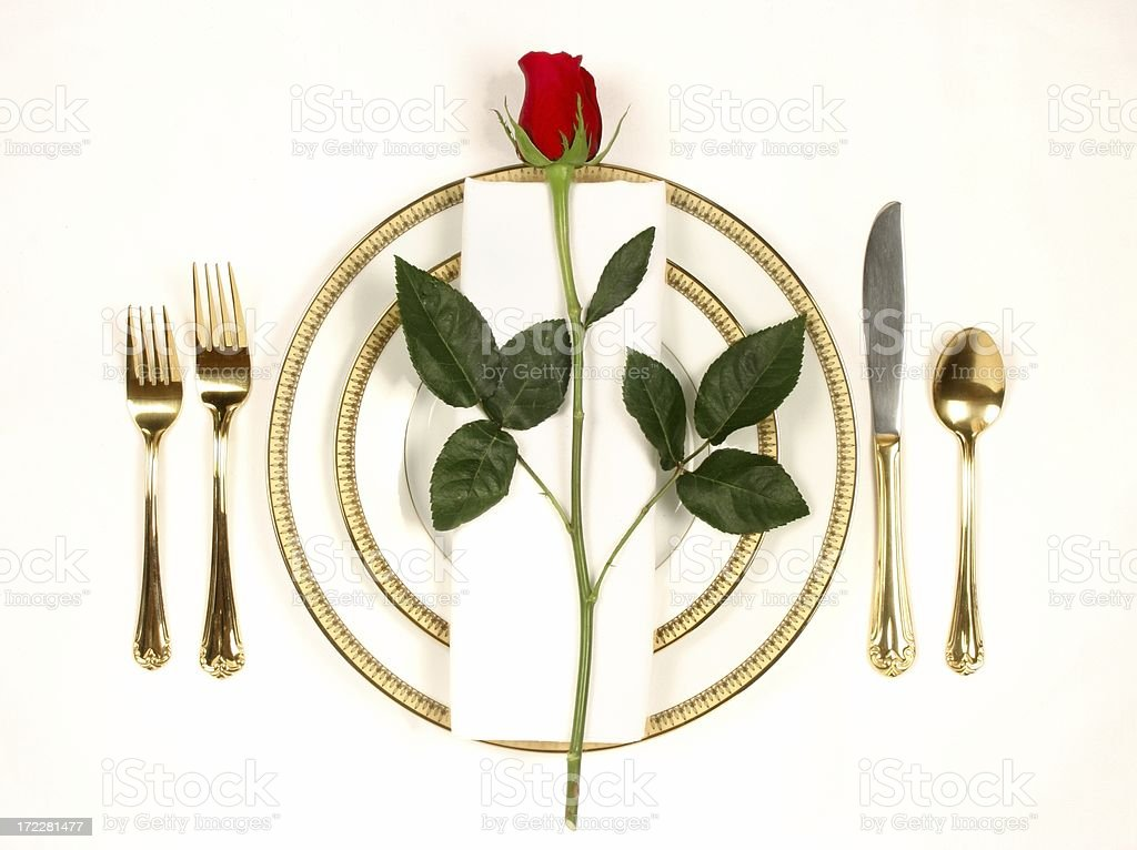 Elegant Table Setting 5 with white and gold plates and rose royalty-free stock photo