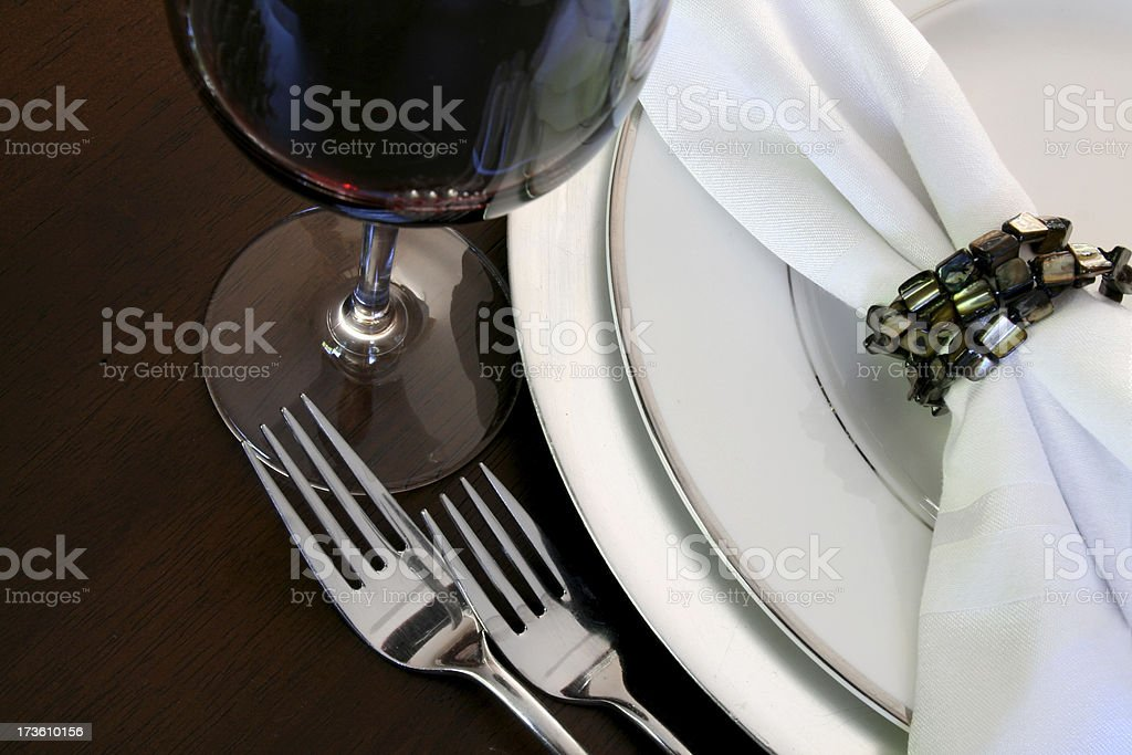 Elegant table setting with napkin ring and a glass of wine stock photo