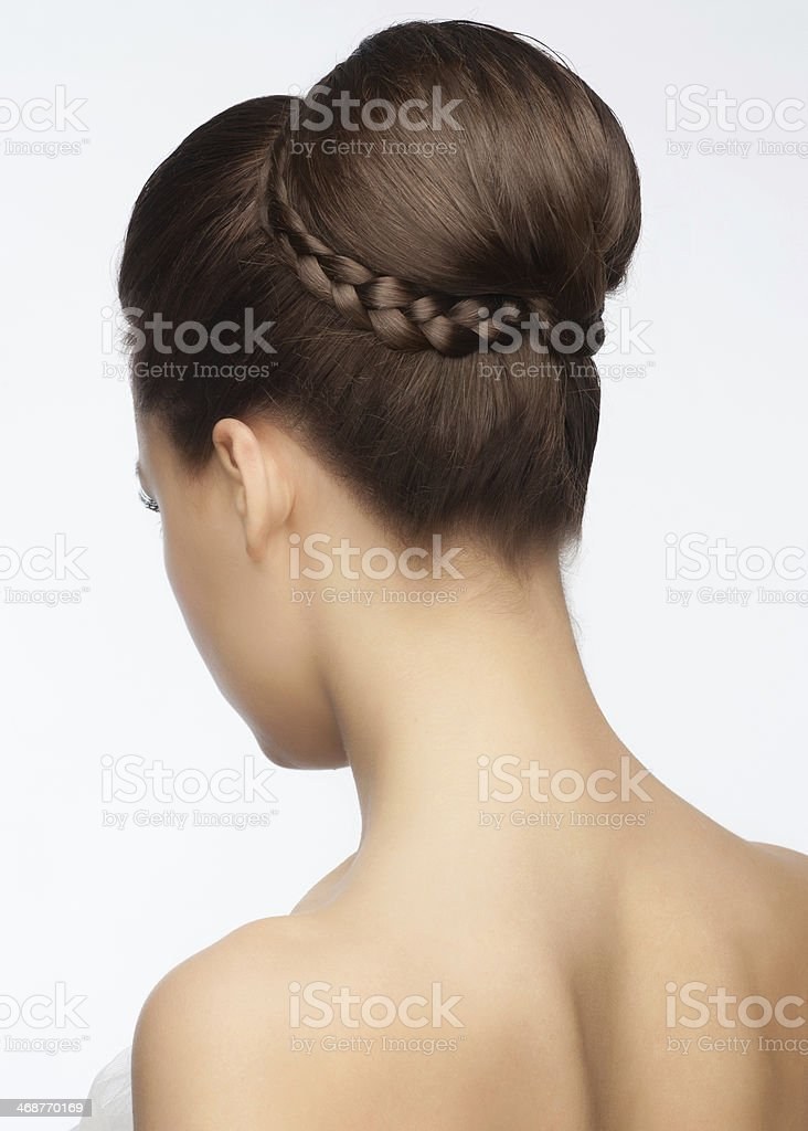 Elegant up-do bridal hairstyle wrapped with braided pigtail stock photo