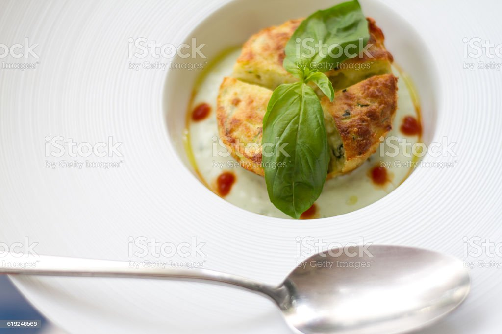 Elegant Veggie Custard-Flan with Basil on Top, Spoon stock photo