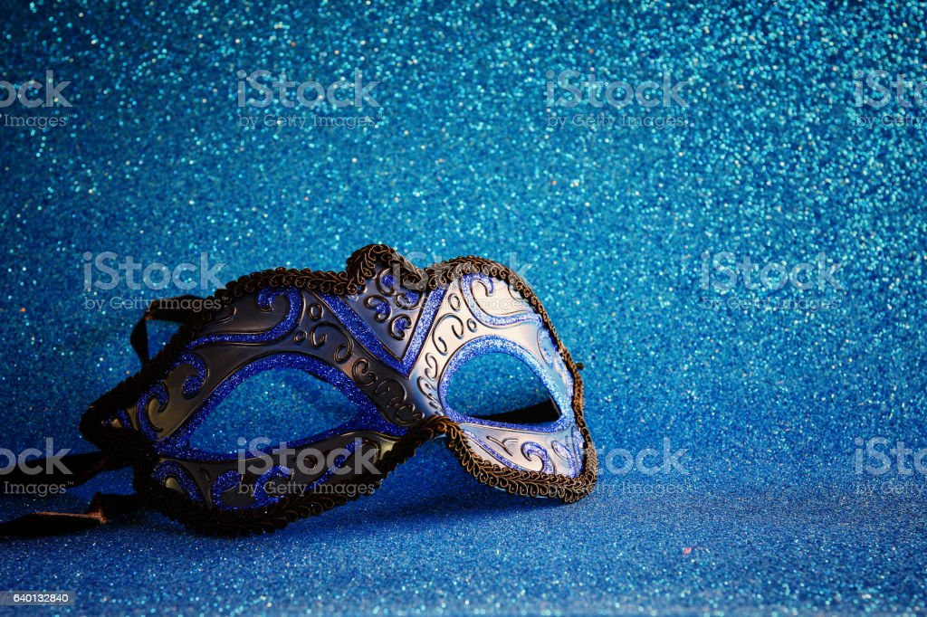 elegant venetian mask on blue glitter background stock photo